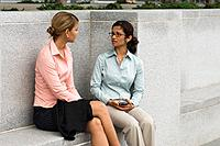 Businesswomen chatting outdoors