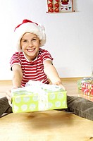 Portrait of girl holding christmas gift and smiling