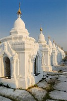 White pagodas in row under blue sky, Kuthodaw Pagoda, Mandalay, Myanmar