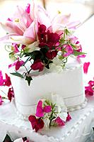 Close up of flowers on wedding cake