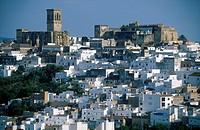 Houses in town with castle in background, Arcos de la Frontera, Andalusia, Spain