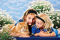 two girls with Maine Coon