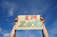 Hands holding EM 2008 sign up