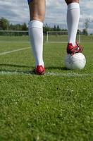 Kicker´s foot standing on ball