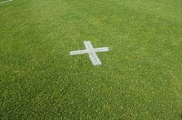 White cross on soccer field