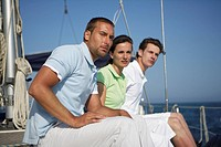 Three people sitting on a boat, looking angry
