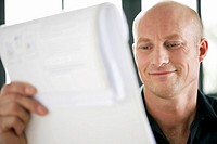 Mature man reading a document
