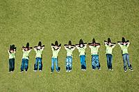 Group of children laying in grass in height ascending order