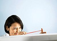Businessman aiming rubber band