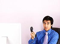 Businessman holding telephone handset