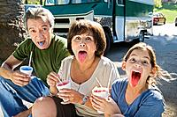 Grandparents and girl eating icy treat