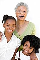 Grandmother smiling with grandchildren
