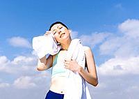 Woman wiping sweat