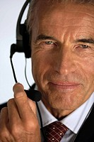 Senior businessman using a headset (thumbnail)