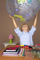Boy 4_5 Years holding a globe over his head