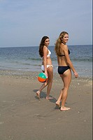 Young women standing at the beach