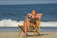 Woman sitting on a beach chair