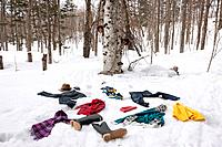 Clothes scattered on snow