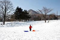 A child walking in the snowfield