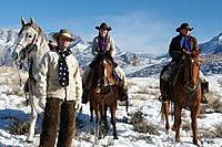 Wranglers out for a ride in winter, Shell, Wyoming. Usa