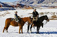 Father and son out for a winter ride, Shell, Wyoming. Usa