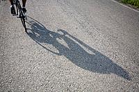 Shadow of a bicyclist casting on road (thumbnail)