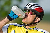 Cyclist drinking water, close_up