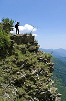 mountaineer towards passo della guardia, ligurian alps, italy
