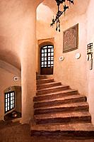 Old winding brick staircase leading up