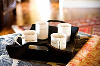 Tray holding four coffee cups