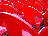 Red plastic chairs in rows