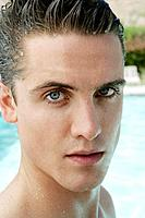 Portrait of wet young man near pool