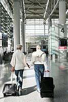 Mature couple walking in airport