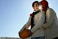 Young affectionate couple with pumpkin