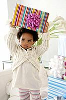 African American child holding birthday present