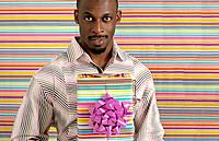 African American man with birthday present