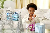 African American child opening presents