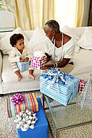 African American mother and child with birthday gifts
