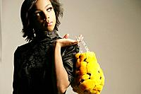 Young stylish African American woman with purse