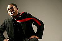 Young happy African American man, studio shot