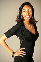 Young African American woman in black dress, studio shot
