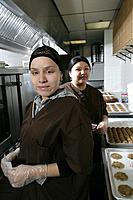 Portrait of female workers in kitchen.