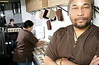 African American male worker in kitchen.