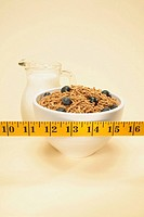 Tape measure over bowl of oat bran