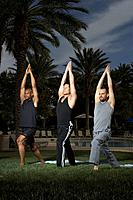 Three men practicing yoga