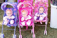 Dolls in fluorescent strollers for sale at concession stand  Hmong Sports Festival McMurray Field St Paul Minnesota USA