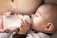 Mother bottle_feeding baby boy 3_6 months