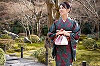 Japan, Kyoto, Enko Temple, woman in kimono walking in temple gardens