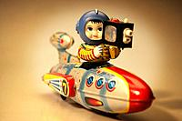Vintage toy astronaut with vehicle