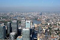 Air pollution. Aerial photograph of Canary Wharf, London, UK. The haze visible over the horizon is photochemical smog, a type of air pollution that re...